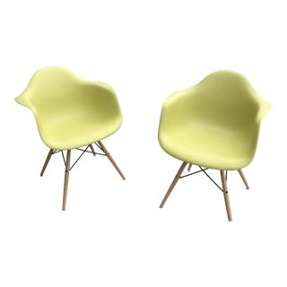 Mid-Century Modern Eames® Molded Yellow Plastic Dowel-Leg Armchair For Sale