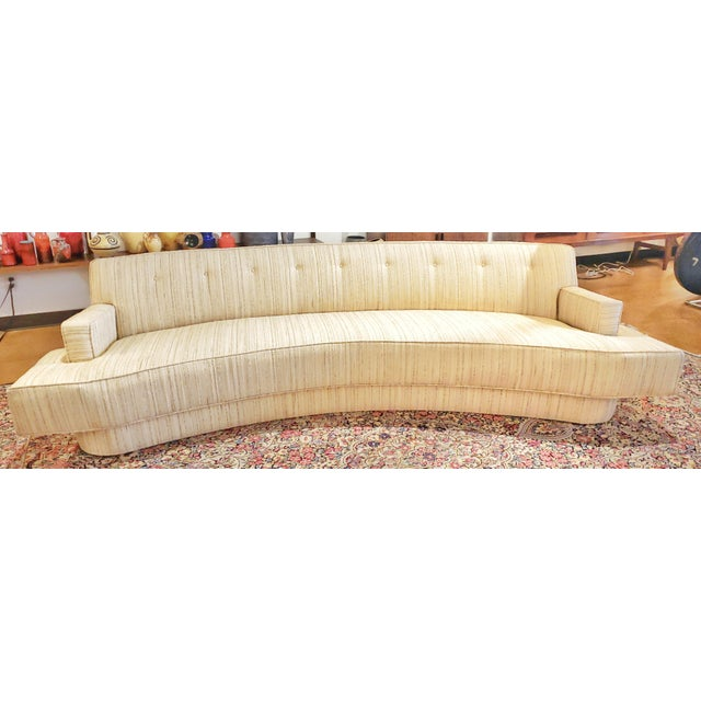 A curved, low-slung sofa, specially commissioned and designed by Harvey Probber for a home in upstate New York. Harvey...