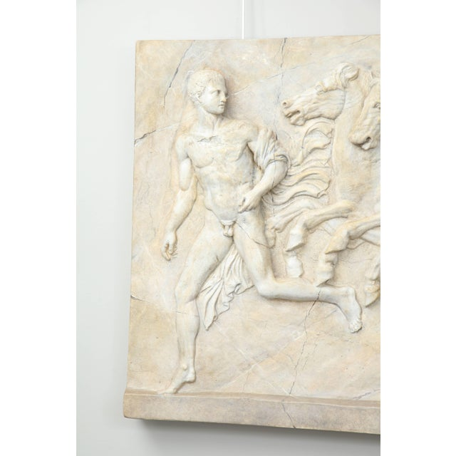 One of two in our inventory, this decorative plaster relief depicts a mythological scene. Hung on a wall or placed atop a...