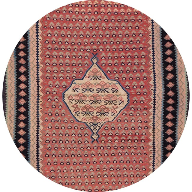 A beautiful hand-woven vintage Kilim runner with a tan field, and multi-color accents an all-over medallion design. This...