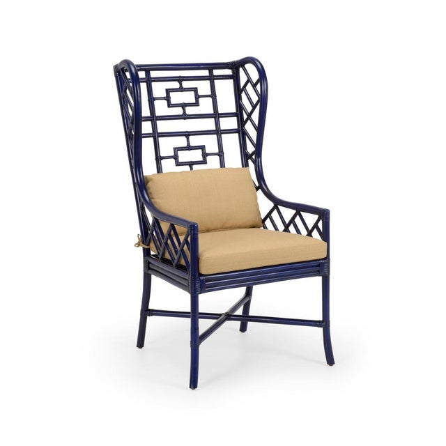 This pretty Asian Inspired rattan wing chair is a great addition to a room that need a little personality. At once...