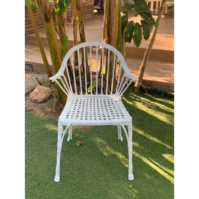 About A Renaissance Revival style figural garden armchair offers cast iron construction with scroll and foliate back...