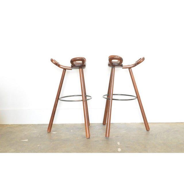 Vintage Spanish Brutalist style barstools c.1950's. Stained Beech wood with metal foot ring and attachments. Stools can be...