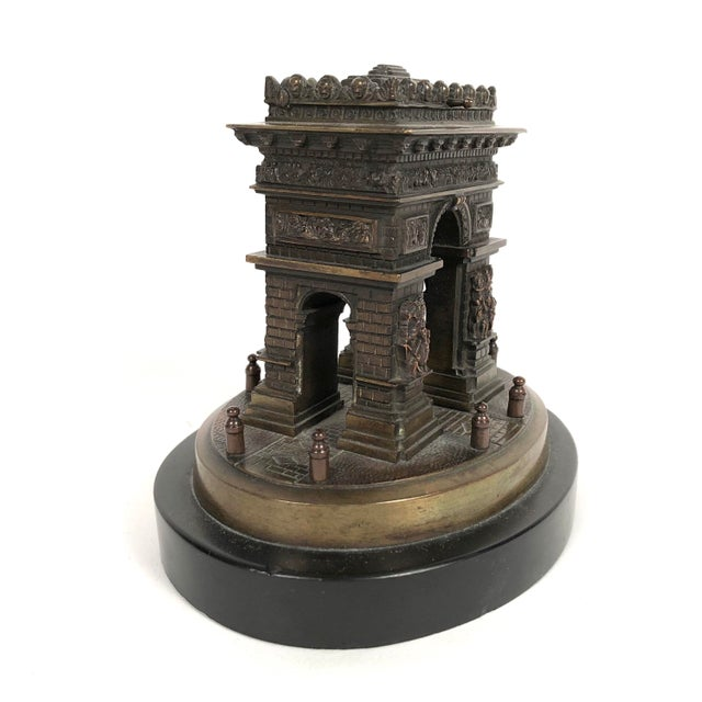 A small Grand Tour bronze architectural model of the Arc de Triomphe in Paris, mounted on anvil black marble base. Created...