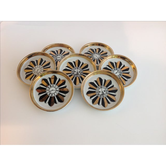 A Shafford Five O'Clock porcelain coasters that were made in Japan. This is a set of 7 porcelain coasters by James R...