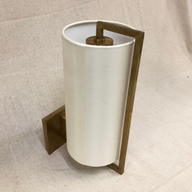 Visual Comfort Framework Wall Sconce in Soft Brass - Showroom Sample Wall sconce with framing hardware in a Soft Brass...