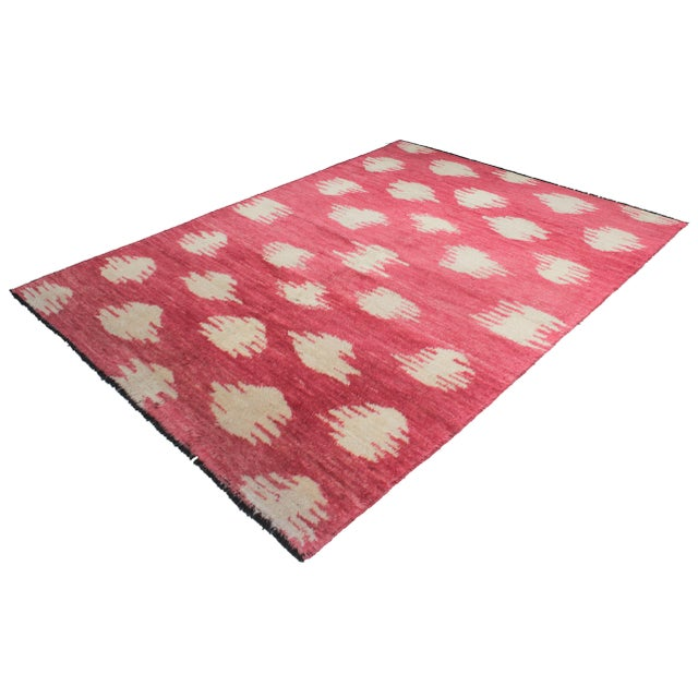 Beautiful handmade Ikat rug, by Aara Rugs. Very modern design and red and ivory color, dyed with all natural dyes made...