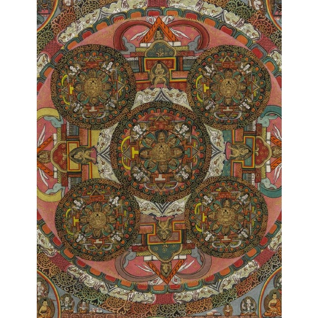 Framed Tibetan Buddhist mandala thangka (painting on fabric), 20th c.. Detailed and intricate painting depicts various...