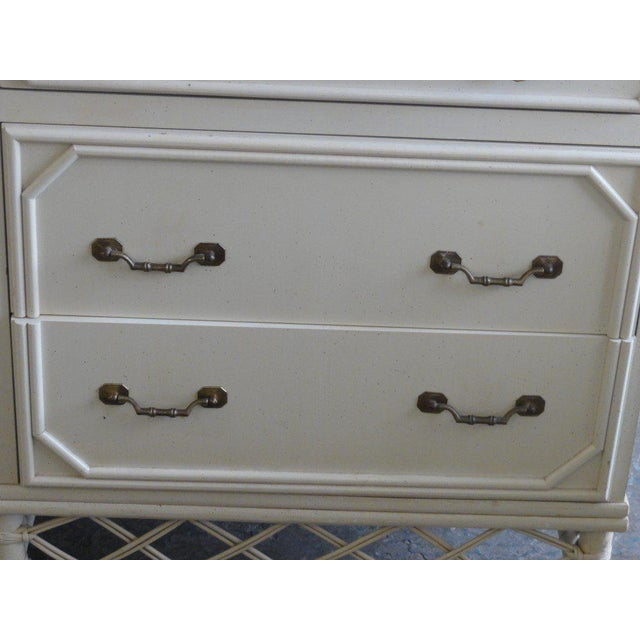 """Ficks Reed 9 Drawer Dresser with a rattan base & brass faux bamboo handles. It measures 33""""H x 72""""Wx20""""D."""