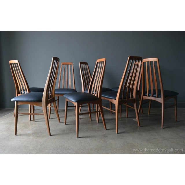 Set of 8 walnut high back 'Eva' dining chairs by Koefoed of Denmark, circa 1965. Professionally restored walnut frames and...