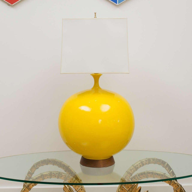 Amazing in it's scale is this yellow ceramic lamp, with a walnut base. (Shade not included).