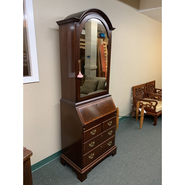 Design Plus Gallery presents a Vintage Secretary. Beautiful mahogany wood is lightly embellished with beveled edges,...