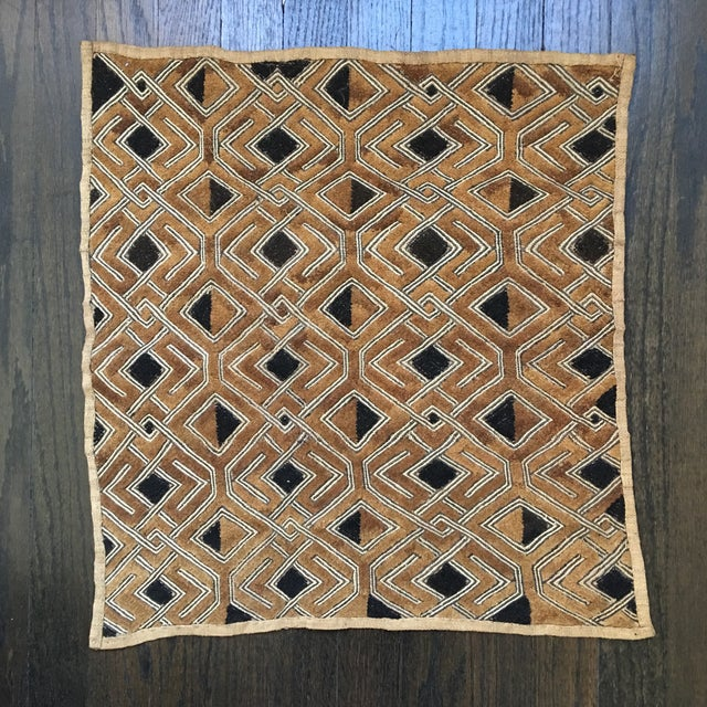 This vintage Kuba textile was bought in Capetown, South Africa in the mid 1990s. The embroidered raffia textiles are from...