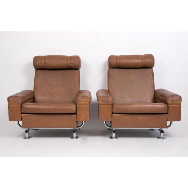 Designed in 1968 by the Danish Illum Wikkelsø for Ryesberg Møbler, this pair of high backed lounge chairs feature the...