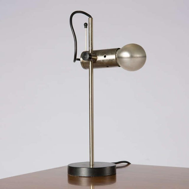 Table lamp model 251 by Tito Agnoli for O-Luce. The piece is a minimal manifesto, summarizing the beauty and the...