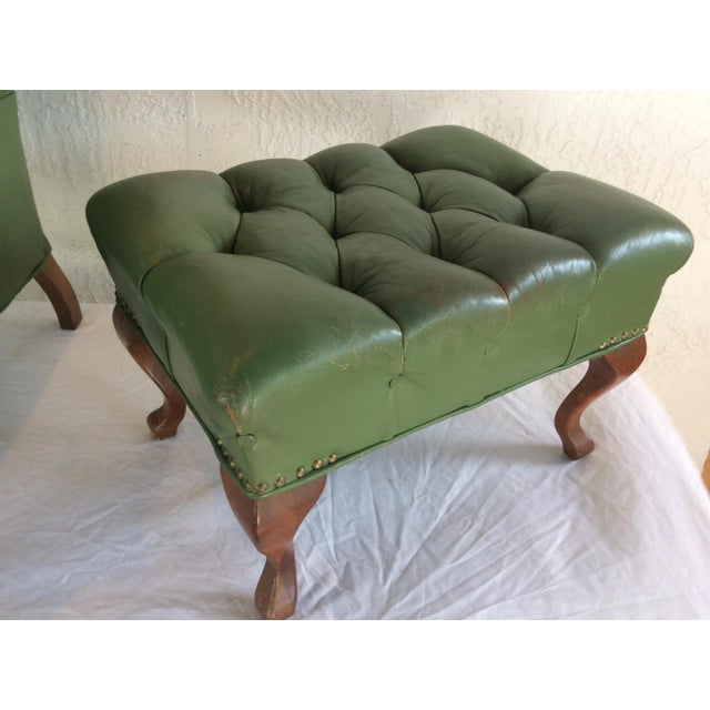 Mid century chair and ottoman, Cherrywood frame with green tufted leather upholstery and nail head trim. Anatomically...