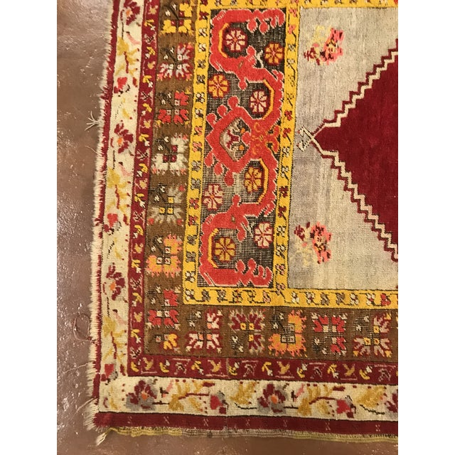 Antique, Turkish wool rug featuring a deep red pattern.