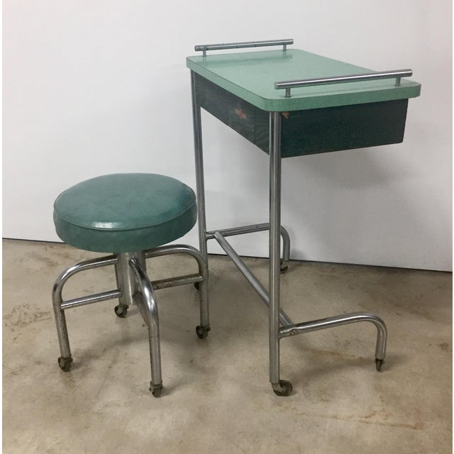 Vintage industrial tubular steel rolling stool and cantilevered table from a barber or beauty shop circa 1940s, made by...