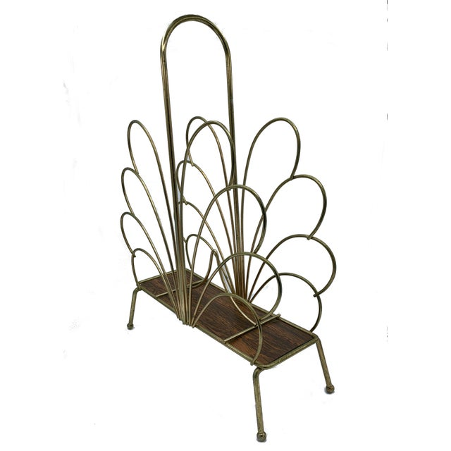 Hollywood Regency Style Vintage Brass Magazine Rack. This vintage brass magazine rack or newspaper stand has a tall...