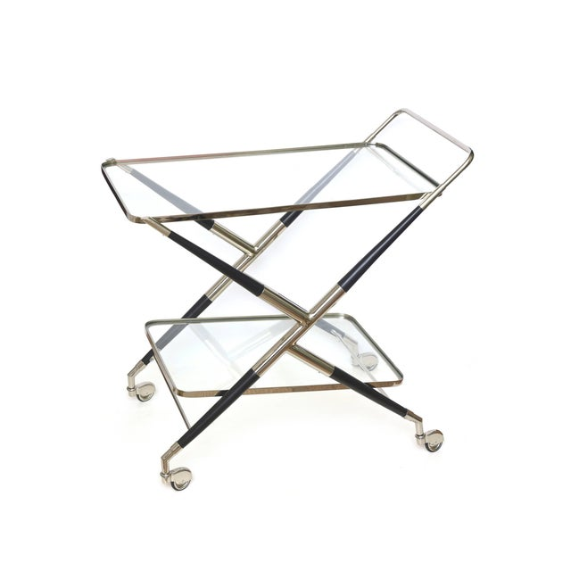 This modern yet midcentury newly restored Cesare Lacca X-frame two-tiered bar cart is Italian and hallmarked made in Italy...