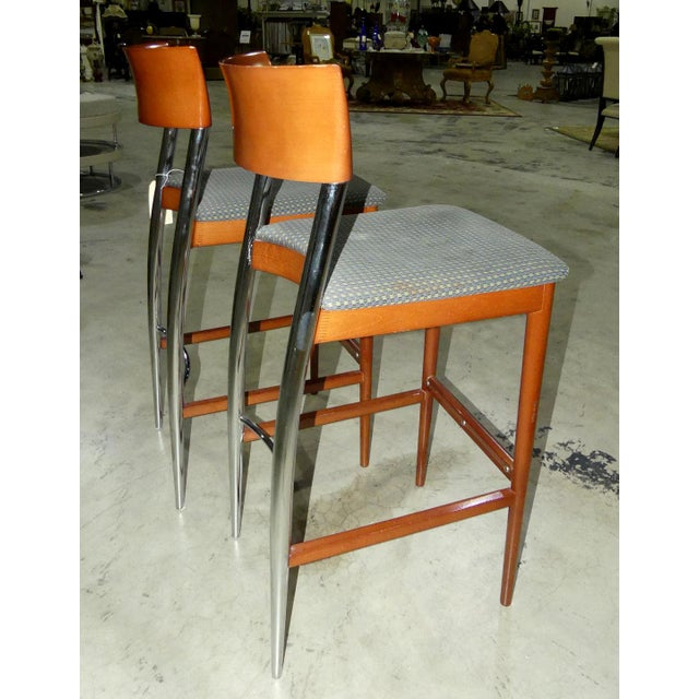 A pair of vintage mid-century Loewenstein bar stools. Fantastic sleek design constructed of wood and chromed steal. Curved...