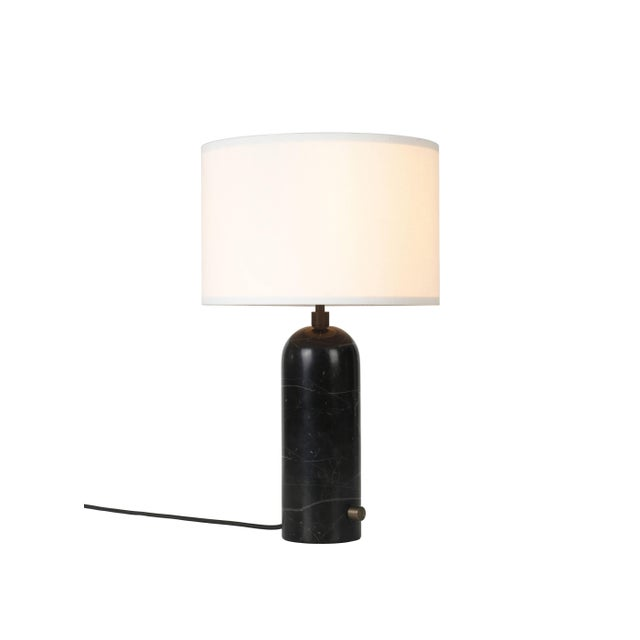 Gravity' black marble table lamp Dimensions: 65 x 41 x 41 cm Material: Marble Designer: Louis Weisdorf Produced by Gubi in...