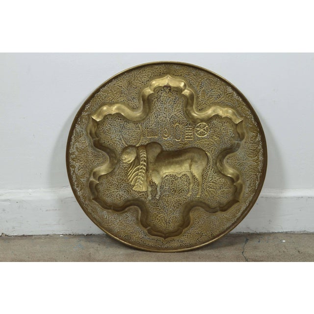 Anglo Raj hanging polished brass tray. Finely hand-chased, hand-cut and hand-hammered with floral repousse designs. The...