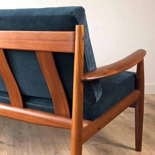 Fully restored, solid teak Grete Jalk-designed sofa with new blue grey velvet upholstery. In pristine condition.