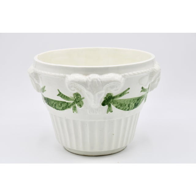 A superb white ceramic planter with four sculptural ram heads, and charming green swags. This unique Vintage Italian...