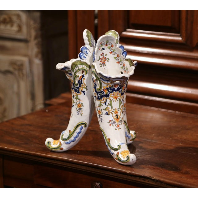 Interesting cornucopias bouquetiere from Normandy, France; crafted circa 1900, the classic vase features hand painted...