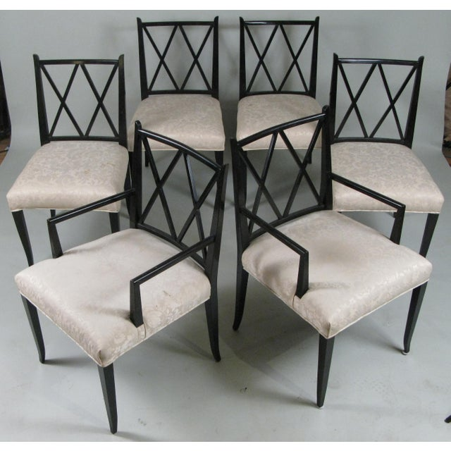 An elegant and Classic set of six ebonized mahogany dining chairs designed by Tommi Parzinger for Parzinger originals,...