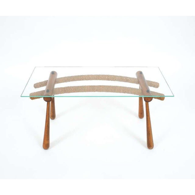 Elegant petite coffee or side table designed by austrian architect Max Kment. Comprised of beechwood, cord and glass, this...