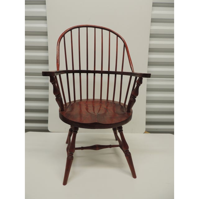 Vintage Child's Windsor Arm Chair. Wood sturdy chair with oval seat and oval back, stained a reddish cherry color. Size:...