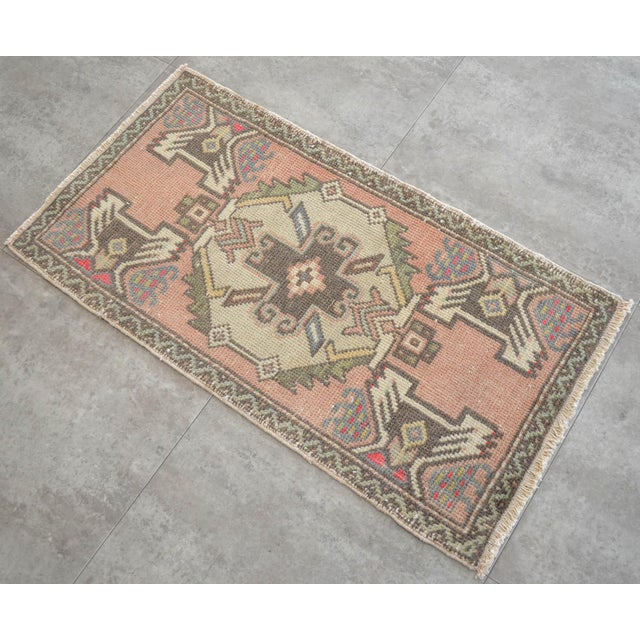 a Vintage Small rug, antique brass background color yastik rug perfect for a small guest bath or in front of the kitchen sink