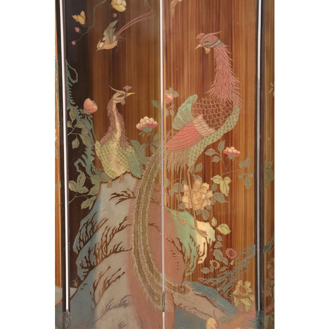 A large caramel hand painted, eight-panel, chinoiserie screen. Beautifully painted with birds and florals.