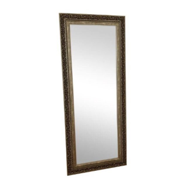 This bronze color floor mirror is beautifully hand carved. The floral pattern gives a vintage charm. Perfect addition in...