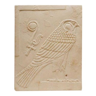 Egyptian Double-sided Limestone Plaque Depicting a Falcon and a Head For Sale