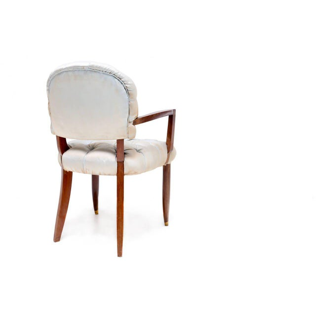 armchair by Jules Leleu in mahogany with gilt-bronze sabots with the original silk buttoned upholstery