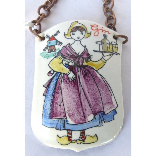 Offered is a single handmade enameled decanter label for Gin made in- Austria,. The tag is signed with with a sticker on...