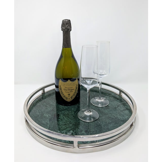 """This 15"""" round green marble tray with chrome handles and sides is both elegant, yet strong with the color emitting a sense..."""