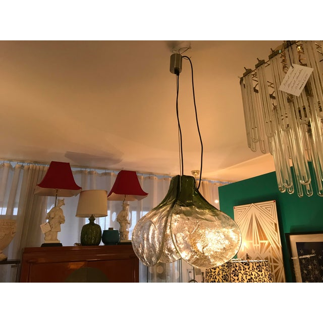 This is a beautiful 1970's, Mazzega Murano Flower Chandelier, by Carlo Nason. The four green and clear textured glass...