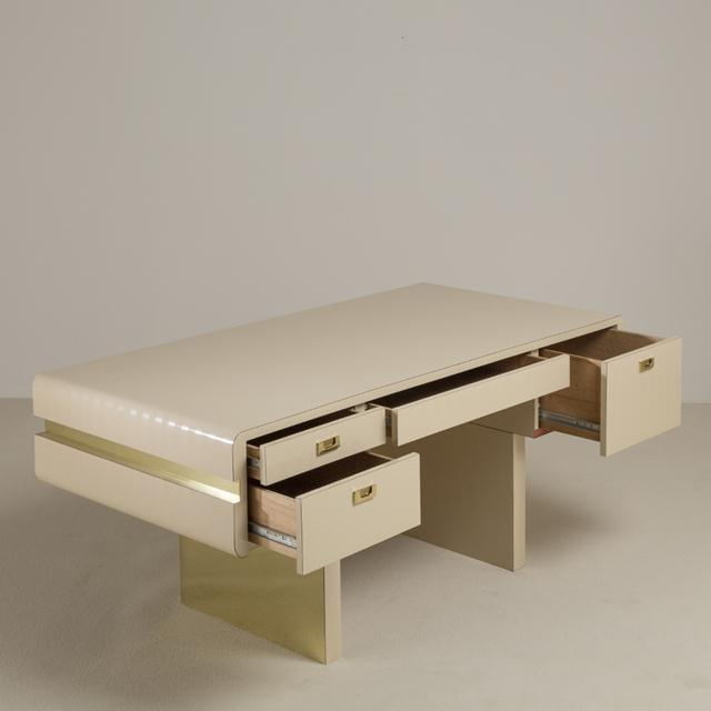 A Leon Rosen for Pace attributed pedestal based brass and cream self striped mica wrapped desk, 1970s. NB: These items are...