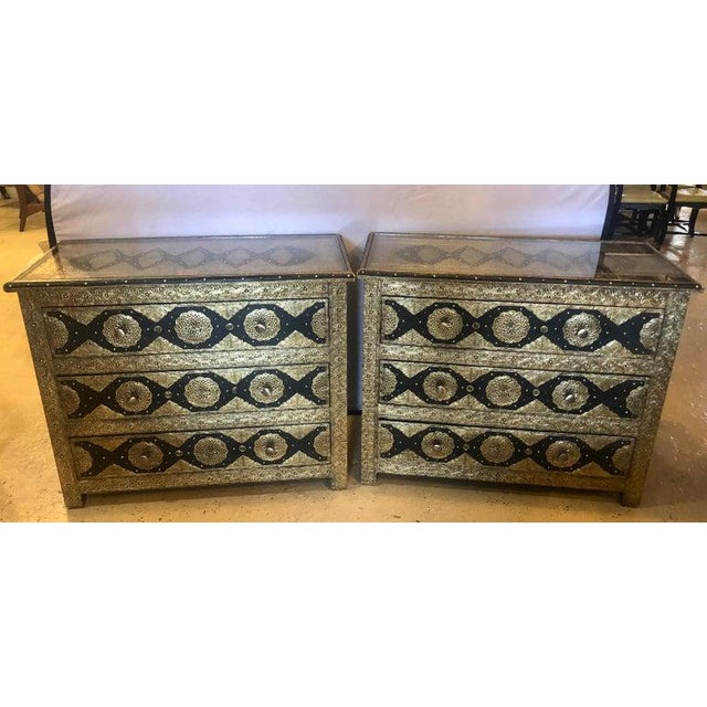 Brass and ebony natural stones and leather inlaid handmade Moroccan commodes. Pair of brass and ebony natural stone and...