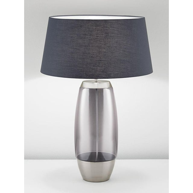 A brushed nickel light with iridescent smoke glass. Clean lines with seamless joints netween glass and the brushed...