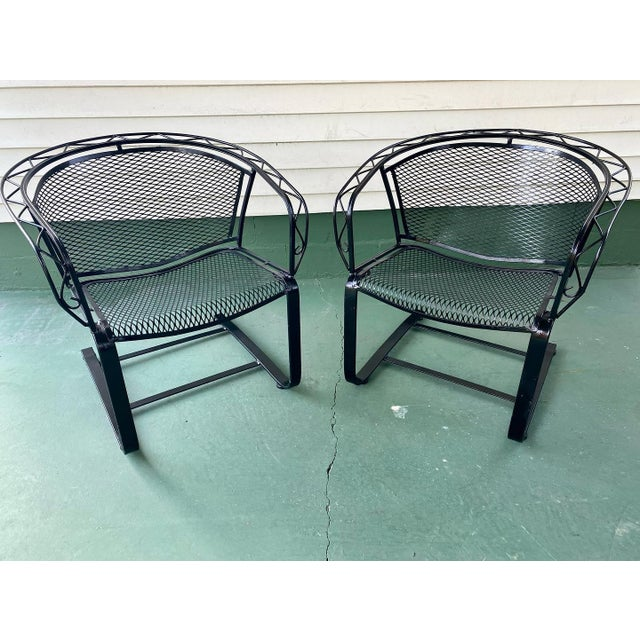 A pair of mid century modern wrought Iron reckoning patio chairs. Great looking modern chairs with a sharp modern look....