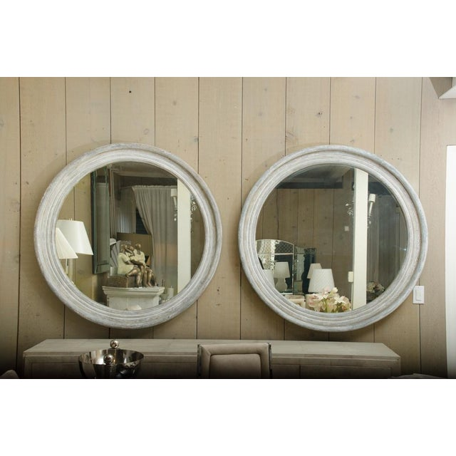 Pair of hand-carved 19th Century round Swedish mirrors with original finish. The mirrors are in excellent condition for...
