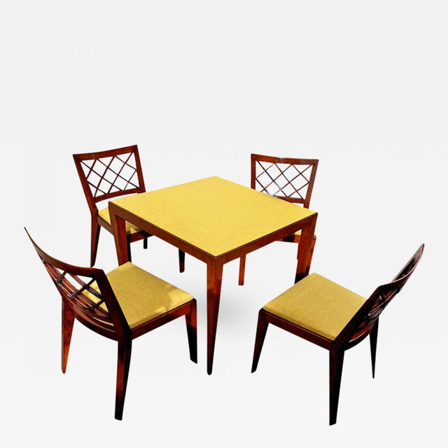 JEAN ROYÈREdocumented game table set and chairs model 'croisillon' newly covered in Kvadrat chine cloth.
