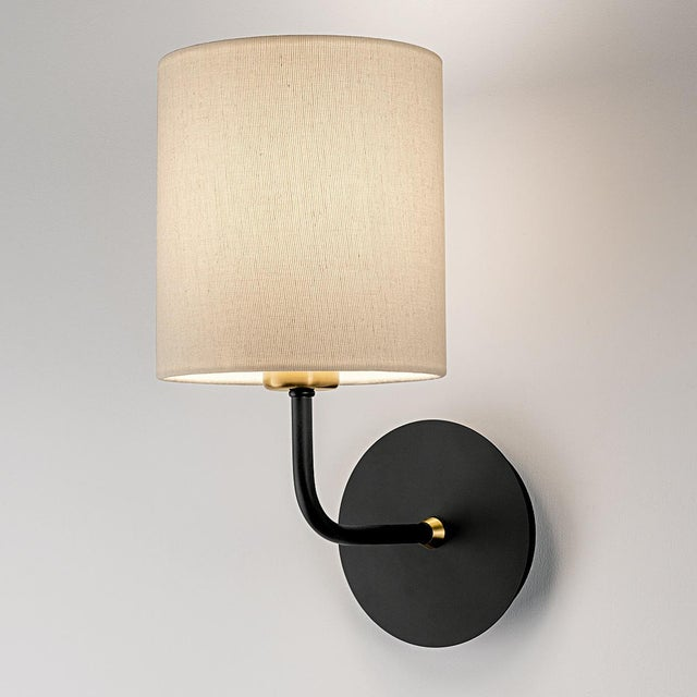 Satin black with brushed brass wall light with a shade in classic style and simplicity. Certification: IP20. Bulb: 1 X E27...