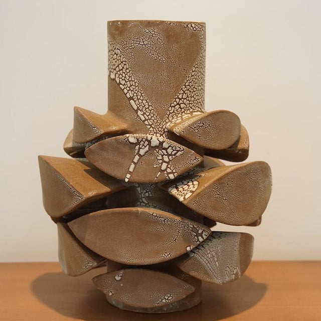This listing is for a contemporary white crackle totem medium vase. Artist: Titia estes Clay: Brown Glaze: Interior Clear,...