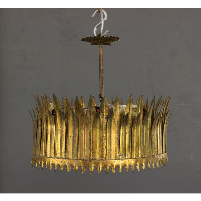 Spanish gilt metal ceiling fixture in the shape of a crown. The glass diffuser is easily removed to change the bulbs...